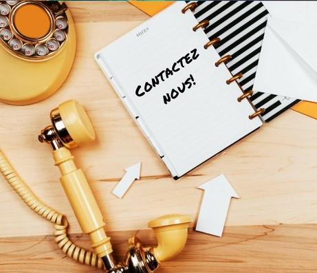 telephone et bloc notes pour contacter